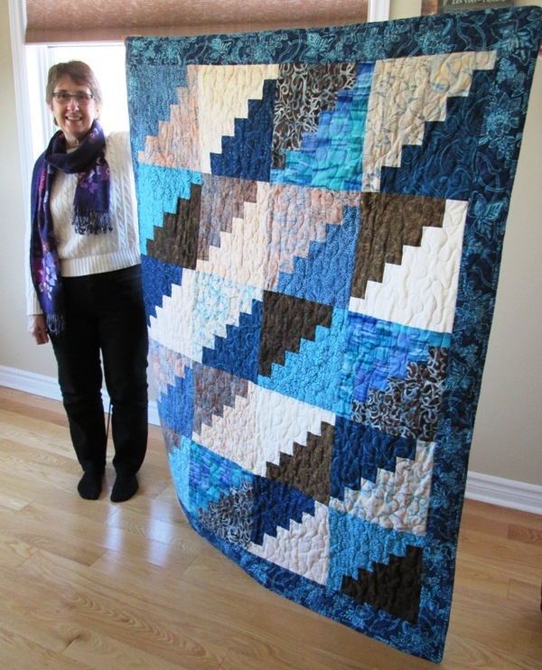 Liz Johnston with 50,000th quilt