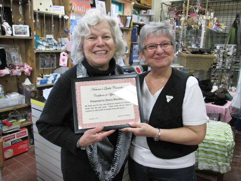 Sherry Woodburn holding Certificate of Appreciation presented by Françoise Miller