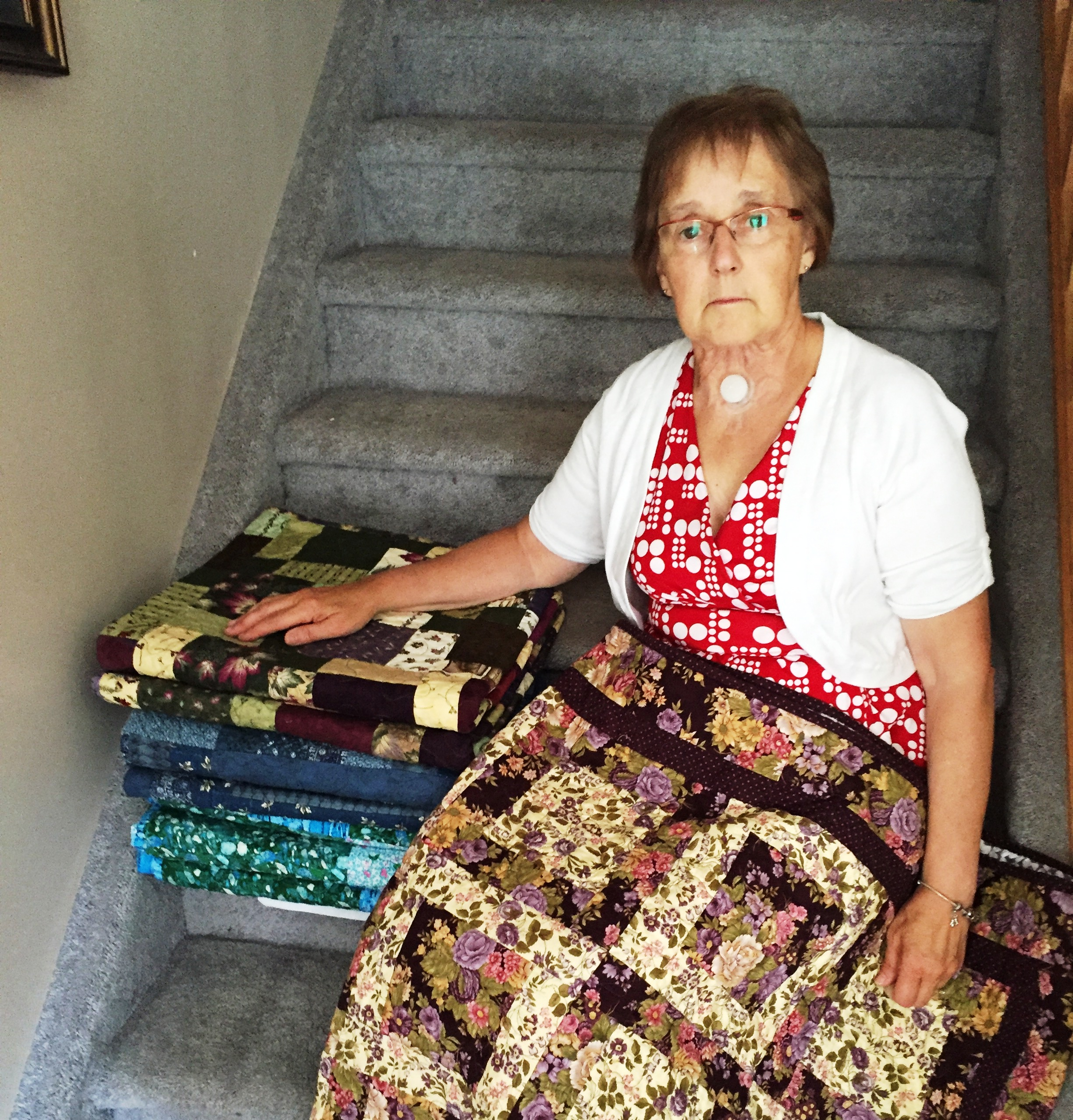 Rita Villeneuve and  		her 100th VQC quilt