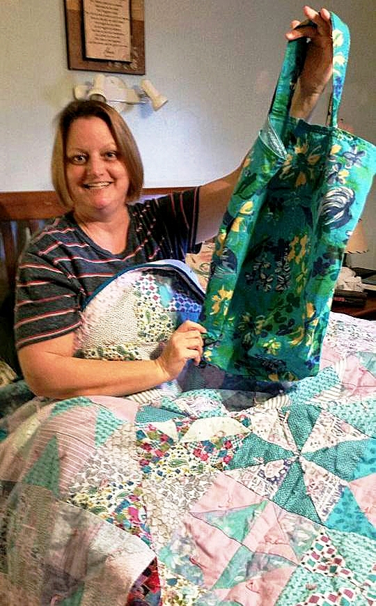 Nancy Smith with quilt and totebag