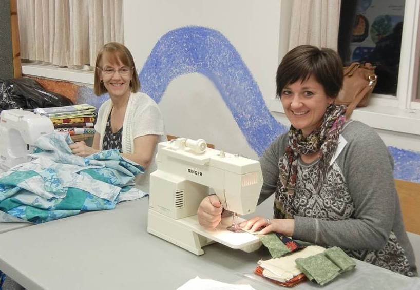 Volunteers from the Beacon Hill Friends Group (Ottawa) sewing quilt pieces