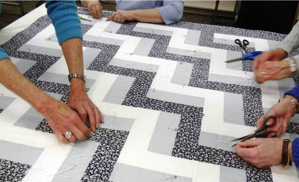 Donated quilt being pinned