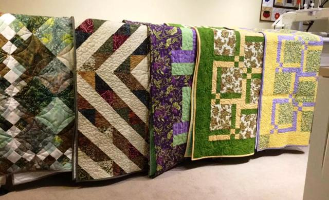 Completed quilts ready for distribution