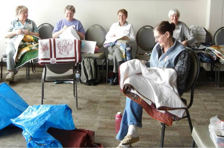 Volunteers at 2014 Quiltathon finishing quilts